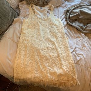 Cream/white colored lace dress with fringe bottom